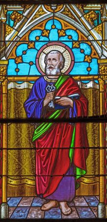 BANSKA BELA, SLOVAKIA - FEBRUARY 5, 2015: The St. Peter the Apostle on the windowpane of St. John the Evangelist church from end of 19. cent. Editorial