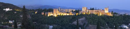 pal: Granada - The panorama of Alhambra palace and fortress complex at dusk.