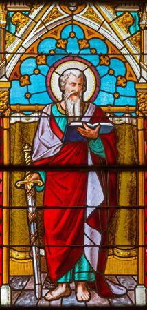 apostle: BANSKA BELA, SLOVAKIA - FEBRUARY 5, 2015: The St. Pautl the Apostle on the windowpane of St. John the Evangelist church from end of 19. cent. Editorial
