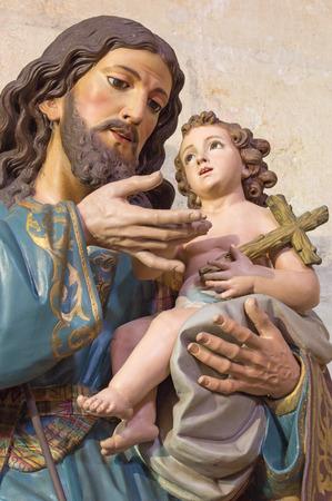 st  joseph: GRANADA, SPAIN - MAY 29, 2015: The St. Joseph carved statue in Basilica San Juan de Dios.