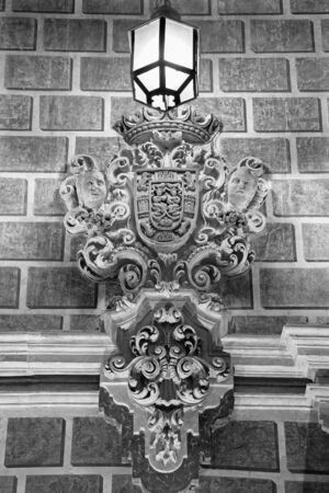 arma: GRANADA, SPAIN - MAY 29, 2015: Detail from facade of Palacio de la Madraza (Madrasah of Granada).