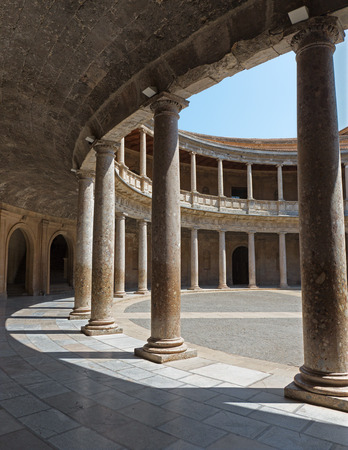 atrium: GRANADA, SPAIN - MAY 30, 2015: The columns and atrium of Alhambra palace of Charles V-