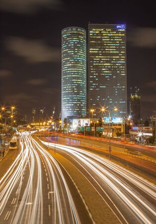 azrieli: TEL AVIV, ISRAEL - MARCH 2, 2015: The skyscrapers of Azrieli Center at night by Moore Yaski Sivan Architects with measuring 187 m (614 ft) in height.