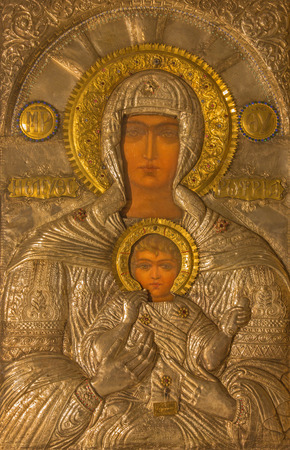 mary mother of jesus: JERUSALEM, ISRAEL - MARCH 3, 2015: The metal icon of Madonna in Church of Holy Sepulchre by unknown artist from Greece (1973).