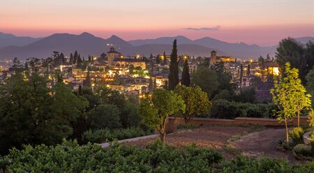 garden city: Granada - The outlook over the the town from Generalife gardens of Alhambra at dusk Stock Photo