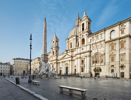 bernini: ROME, ITALY - MARCH 27, 2015:  Piazza Navona in morning and Fontana dei Fiumi by Bernini and Egypts obelisk and Santa Agnese in Agone church