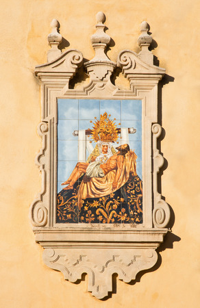 mary mother of jesus: CORDOBA, SPAIN - MAY 26, 2015: The ceramic tiled Pieta on the facade of church Iglesia de San Augustin by artist Mensaque Rodriguez from 20. cent. Editorial