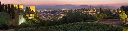 the  alhambra: Granada - The outlook over the Alhambra and the town from Generalife gardens at dusk Stock Photo