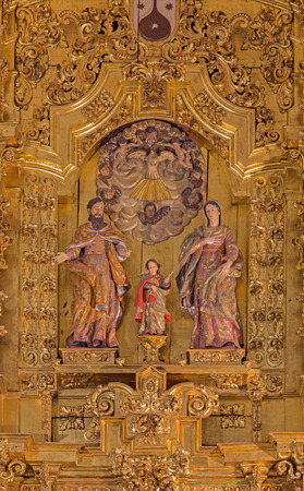 convento: CORDOBA, SPAIN - MAY 26, 2015: The carved Holy Family sculptural group on the main altar in church of Monastery of st. Ann and st.Joseph (Convento de Santa Ana y San Jose) by Sanchez de Rueda (1710).