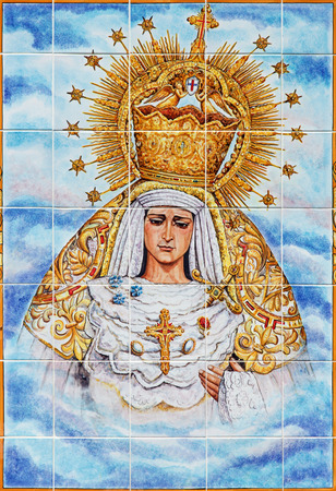 cried: CORDOBA, SPAIN - MAY 26, 2015: The ceramic tiled, cried Madonna on the facade of church Iglesia de Nuestra Senora de Gracia by Catalina Alaide from 20. cent.