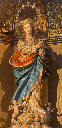 polychrome: GRANADA, SPAIN - MAY 29, 2015: The carved and polychrome baroque statue of Immaculate Conception in church iglesia San Hipolito by Teodosio Sanchez Canada and Martin Lopez (1735).