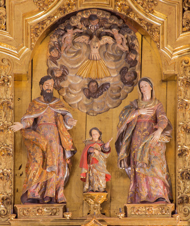 saint mary: CORDOBA, SPAIN - MAY 26, 2015: The carved Holy Family sculptural group on the main altar in church of Monastery of st. Ann and st.Joseph (Convento de Santa Ana y San Jose) by Sanchez de Rueda (1710).