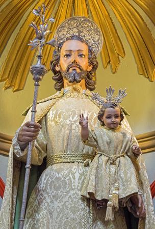 vested: CORDOBA, SPAIN - MAY 26, 2015: St. Joseph traditional vested statue in Church Eremita de Nuestra Senora del Socorro on side altar by Juan Morilo from 18. cent.