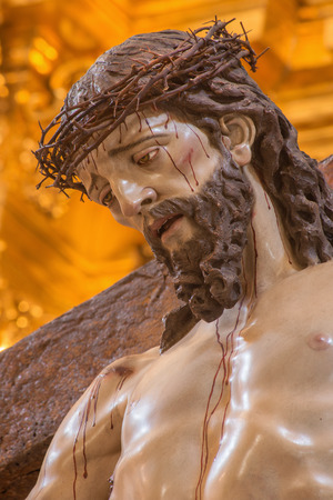 vestment: CORDOBA, SPAIN - MAY 26, 2015: The head of Christ descending from the cross statue in church of Monastery of st. Ann and st.Joseph (Convento de Santa Ana y San Jose). Editorial