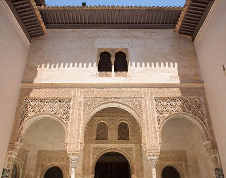 mudejar: GRANADA, SPAIN - MAY 30, 2015: One of atrium in mudejar Nasrid palace with the typically stucco. Editorial