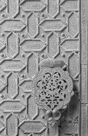 mudejar: CORDOBA, SPAIN - MAY 28, 2015: The detail of mudejar bronze gate of the Cathedral.