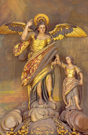 polychrome: CORDOBA, SPAIN - MAY 27, 2015: The carved polychrome statue of archangel Raphael (Santo Angel) patron of the Town from 18. cent. on the altar in church Convento de Capuchinos (Iglesia Santo Anchel).