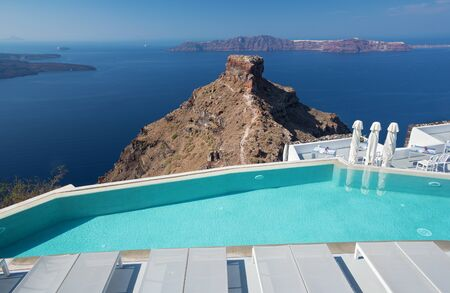 Santorini - The outlook over the luxury resort in Imerovigili to caldera with the cruises. Stock Photo