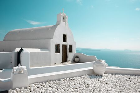 island: Santorini - The look to little white church in west part of Oia over the caldera.