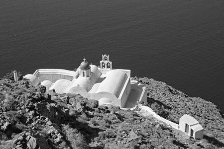 typically: Santorini - The look to typically little church Theoskepasti in Imerovigli under the Skaros.