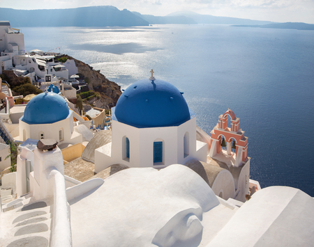 typically: Santorini - The look to typically blue church cupolas in Oia over the caldera.
