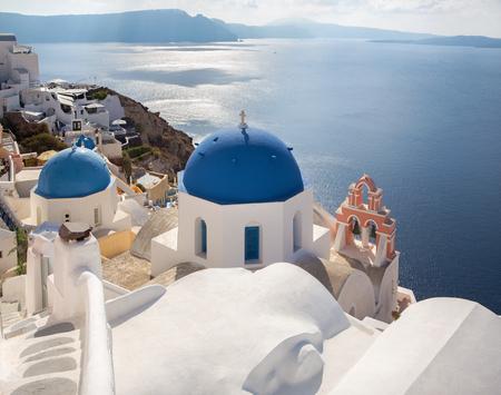 Santorini - The look to typically blue church cupolas in Oia over the caldera.