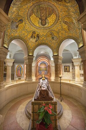 crypt: JERUSALEM, ISRAEL - MARCH 3, 2015: The crypt of Dormition abbey with statue of death Virgin Mary and mosaic on wault by Benedictine Radbod Commandeur from the Abbey of Maria Laach (20. cent.). Editorial