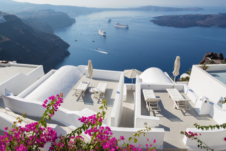 outlook: Santorini - The outlook over the luxury resort in Imerovigili to caldera with the cruises. Stock Photo