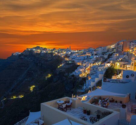 firostefani: SANTORINI, GREECE - OCTOBER 6, 2015: The Fira at morning dusk and the Firostefani Editorial
