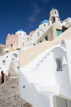 cupolas: Santorini - The look to typically blue churches cupolas in Oia with the white house stairs.