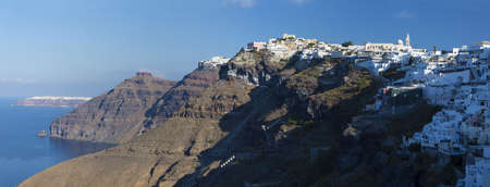 firostefani: SANTORINI, GREECE - OCTOBER 6, 2015: The Fira and Firostefani in morning light and the Scaros castle, Imerovigli and Oia in background.