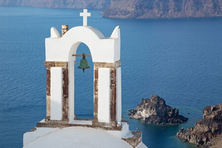 typically: Santorini - The bell tower of typically little church in Oia (Ia)