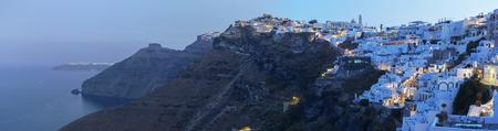 firostefani: SANTORINI, GREECE - OCTOBER 6, 2015: The panorama of Fira morning dusk and Firostefani at morning dusk.