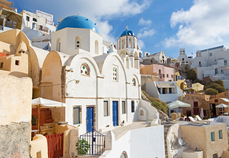 typically: Santorini - The look to typically blue-white churches in Oia. Stock Photo