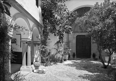 convento: CORDOBA, SPAIN - MAY 26, 2015: The atrium and late gothic potal on church of monastery Convento Santa Marta.