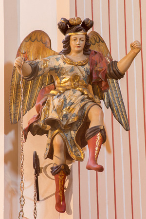polychrome: CORDOBA, SPAIN - MAY 26, 2015: The carved polychrome baroque statue of angel in presbytery from church of Monastery of st. Ann and st.Joseph (Convento de Santa Ana y San Jose).
