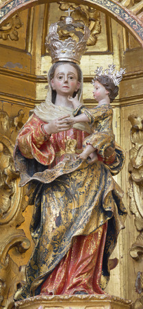 marta: CORDOBA, SPAIN - MAY 26, 2015: The carved polychrome statue of Madonna from 17. cent. in church of monastery Convento Santa Marta.