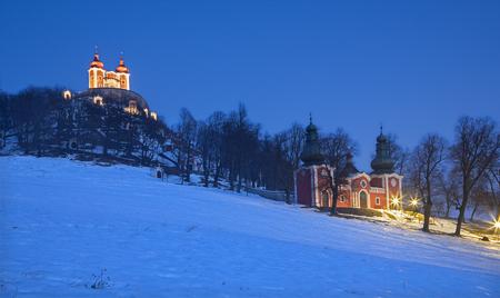 calvary: Banska Stiavnica - The baroque calvary built in years 1744 - 1751 in winter dusk. Stock Photo