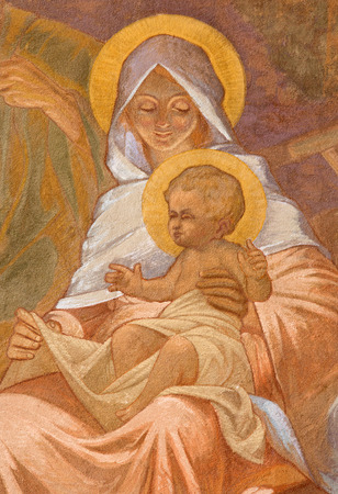 adoration: BANSKA BELA, SLOVAKIA - FEBRUARY 5, 2015: The fresco of Holy Family in St. John the Evangelist church by Jan Antal (1905) as the detail of Adoration of sheepherds scene.
