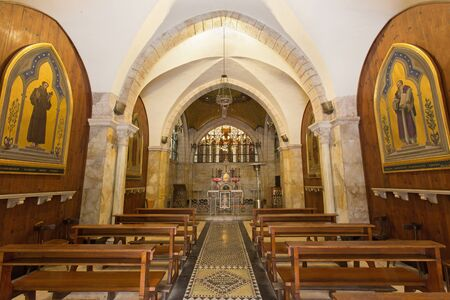 church: JERUSALEM, ISRAEL - MARCH 4, 2015: The nave of Church of Flagelltion on Via Dolorosa from begin of 20. cent. by architect Antonio Barluzzi (windowpane Cesare Picchiarini).