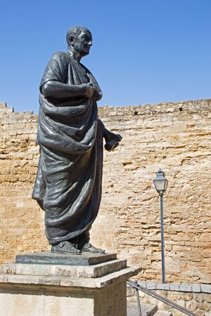 seneca: CORDOBA, SPAIN - MAY 25, 2015: The statue of philosopher Lucius Annaeus Seneca the Younger by Amadeo Ruiz Olmos (1913 - 1993) and medieval gate Puerta del Almodovar. Editorial