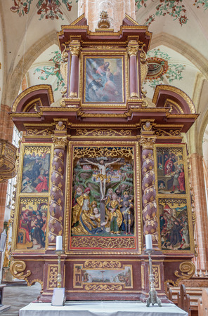 polychrome: NEUBERG AN DER MURZ, AUSTRIA - SEPTEMBER 13, 2015: The side carved polychrome early baroque altar completed in year 1668 with the Crucifixion in the center in Dom of Neuberg by unknown artist .
