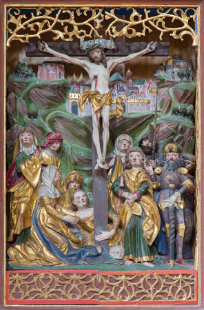 polychrome: NEUBERG AN DER MURZ, AUSTRIA - SEPTEMBER 13, 2015: The polychrome carved Crucifixion on side altar of gothic Dom by unknown artist from year 1505.