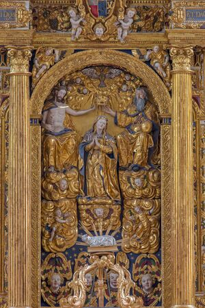 polychrome: NEUBERG AN DER MURZ, AUSTRIA - SEPTEMBER 13, 2015: The carved polychrome Coronation of Virgin Mary on early baroque main altar of Dom by Hans Georg Mader, Jakob Huldi, Thoman Stainmüllner (1612).