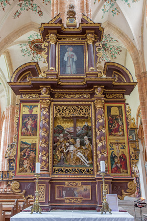 polychrome: NEUBERG AN DER MURZ, AUSTRIA - SEPTEMBER 13, 2015: The side carved polychrome early baroque altar completed in year 1668 with the Deposition (Pieta) in the center in Dom of Neuberg by unknown artist .