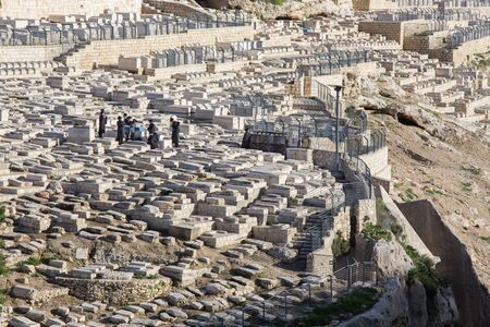 jews: JERUSALEM, ISRAEL - MARCH 3, 2015:  The jewish cemetery on the Mount of Olives and burial of orthodox Jews.
