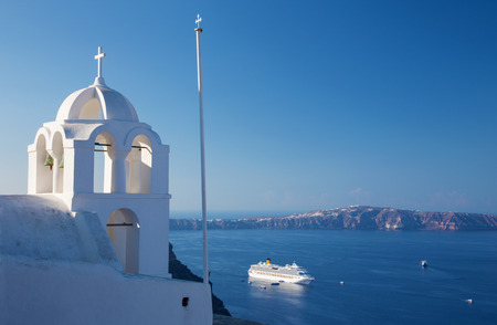 outlook: Santorini - The outlook from Fira ower the church tower to caldera and the cruise. Stock Photo