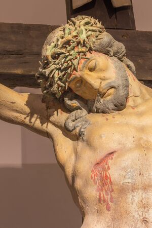 19 years: BANSKA STIAVNICA, SLOVAKIA - FEBRUARY 19, 2015: The detail of carved statue of Christ on the cross as the part of baroque Calvary from years 1744 - 1751.