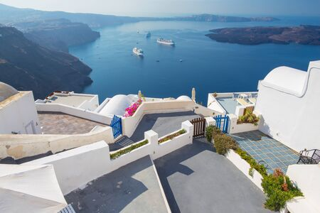 Santorini - The outlook over the luxury resort in Imerovigili to caldera with the cruises. Editorial