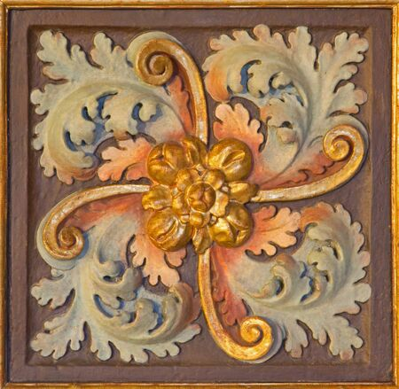 polychrome: CORDOBA, SPAIN - MAY 26, 2015: The baroque carved and polychrome floral decoration in church Iglesia de San Augustin.